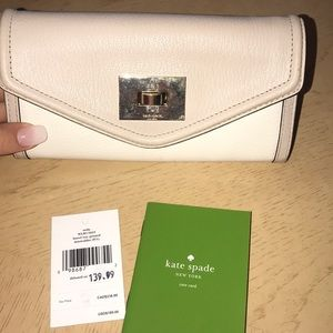 Brand New with tags Kate spade nude & white wallet
